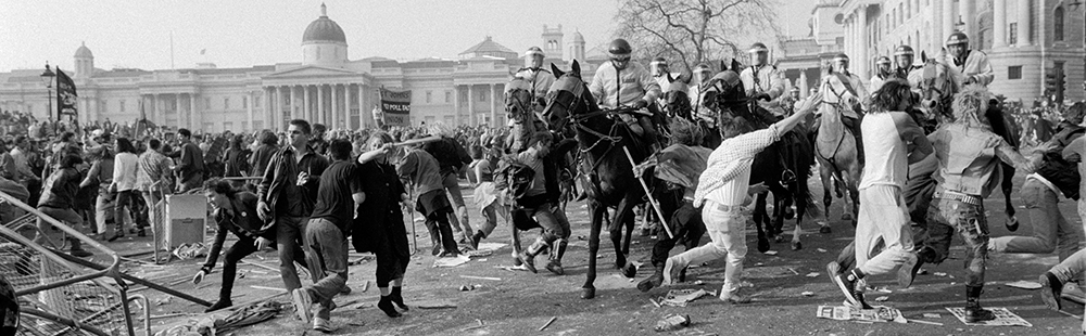The day that finished Thatcherism.  Anti-Poll Tax riot in Trafalgar Square, London  1990.  A series of small riots and protests swept the country culminating in a mass march on Downing Street.  Swept up to Trafalgar Square by police and subject to repeated attacks by police mounted on horseback and in vehicles, the protesters dispersed through the West End shopping areas starting fires and causing tens of millions of pounds damage.