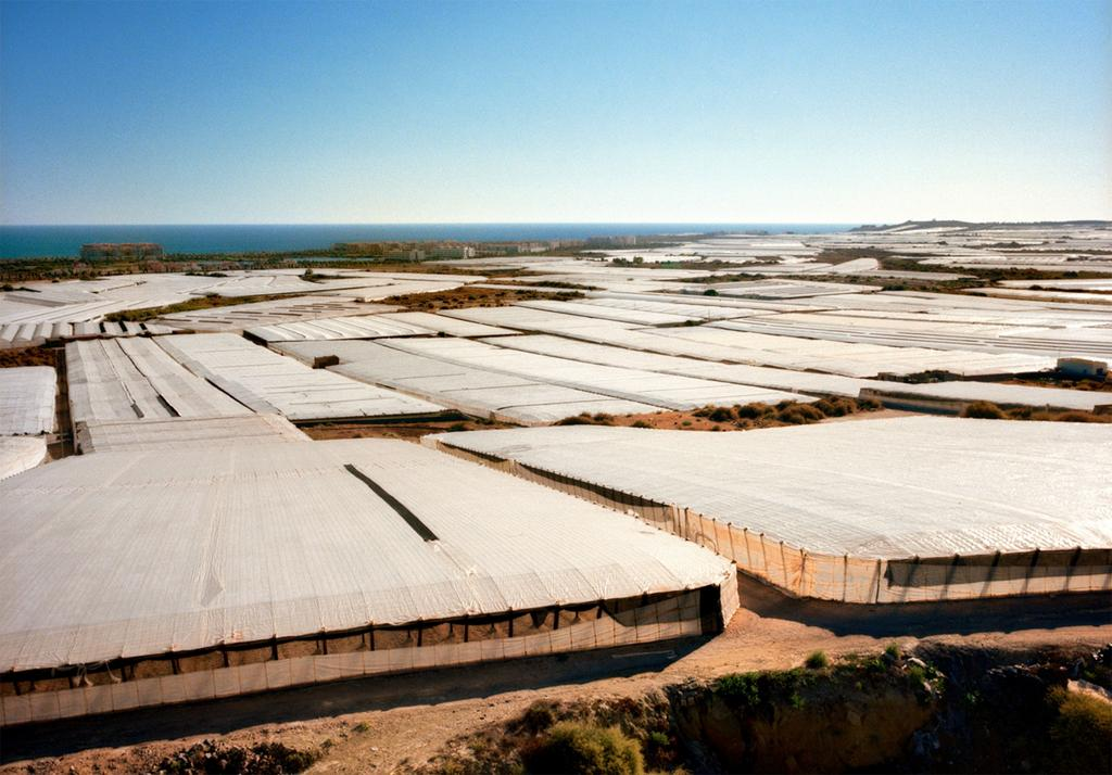Alfredo Caliz,  Swathes of giant greenhouses cover the land like a blanket. Intensive agriculture in the province of Almeria has changed the fortunes and the landscape of this once impoverished part of the country, 2008.